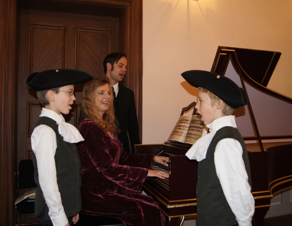 Future members of St. Thomas's Boys Choir wearing Baroque costumes